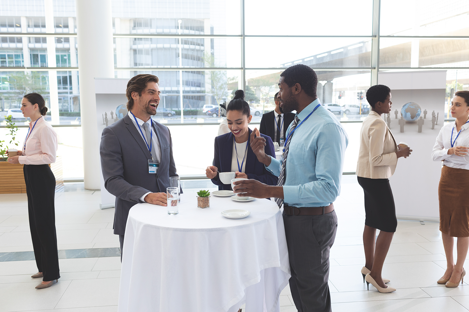 Young business professionals drinking and chatting at a networking event